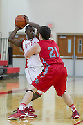 Belton's Kyle Battle attempts to pass over Ben Strong of Vista Ridge during the Leander ISD Tournament held Friday.  The Rangers beat Belton 63-46 at Vista Ridge.