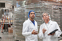 Quality control workers inspecting at bottling plant