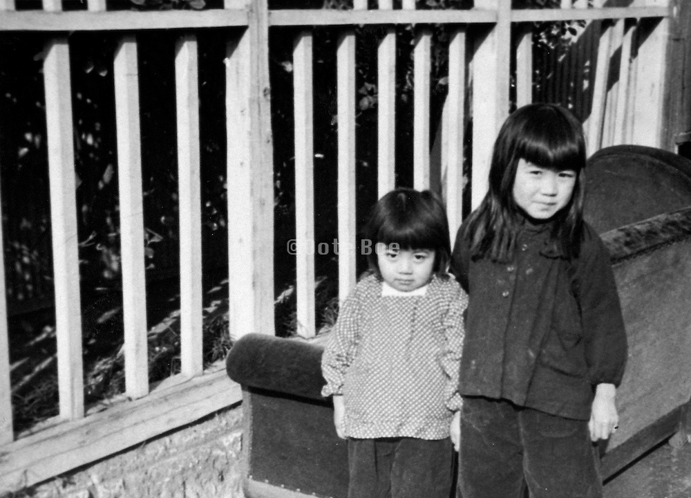 old photo of two Asian children