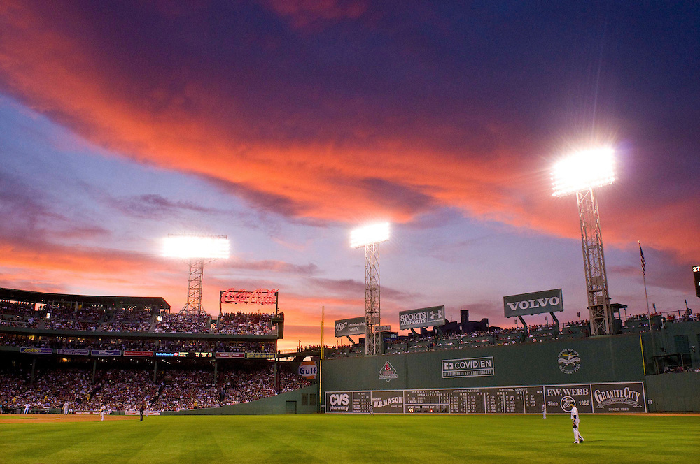Historic Fenway Park, located at 4 Yawkey Way, hosted its first professional baseball game on April 20, 1912. The Red Sox defeated the New York Highlanders, later known as the Yankees, before 27,000 fans,7-6 in 11 innings.The historic Fenway Park, home to the Boston Red Sox. The evening sun casts and orange glow on the field.