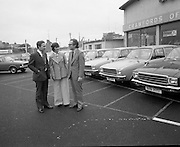 Tubberware Girls - New Cars 31/05/1976<br /> 05/31/1976<br /> 31st May 1976<br /> Pictured from left to right Michael Rowe, Managing Director Chrysler (Ireland) Limited, Louise Coleman, Tupperware Distributor and Hugh Crawford, Managing Director Crawford's Dun Laoghaire. They are pictured next to Hillman Hunter cars.