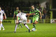 Forest Green Rovers Darren Carter(12) on the ball during the Vanarama National League match between Forest Green Rovers and Tranmere Rovers at the New Lawn, Forest Green, United Kingdom on 22 November 2016. Photo by Shane Healey.