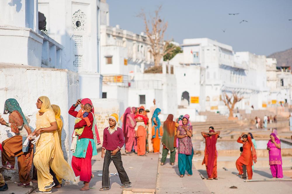 Women in colorful saris by Pushkar lake (India)