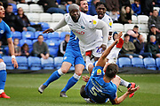 Wycombe forward Adebayo Akinfenwa (20) gets a foot in an unfortunate place from Peterborough Utd defender Ryan Tafazolli (5) during the EFL Sky Bet League 1 match between Peterborough United and Wycombe Wanderers at London Road, Peterborough, England on 2 March 2019.