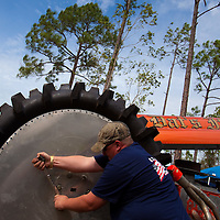 "NAPLES, FL -- March 6, 2011 -- Erick Nielsen puts 68"" tire on the modified 4WD Dat's It in the pits during the Swamp Buggy Races at the Florida Sports Park in Naples, Fla., on Sunday, March 6, 2011.  The races originated in the 1940's by bored hunters and draws thousands of fans three times a year to take in the buggies and jeep compete in the swamp. (Chip Litherland for ESPN the Magazine)"