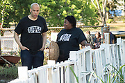 Democratic presidential hopeful Senator Cory Booker, left, chats with Germaine Jenkins, the Chief Farm Officer of the Fresh Future Farm during a visit April 27, 2019 in North Charleston, South Carolina. Booker spent his 50th birthday helping out at the urban farm during his Justice For All tour.