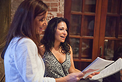 Jolie Fries Singer, right, with sister in law Pamela Fries sing the Dayenu.  The Hebrew Congregation of St. Thomas celebrate Passover Seder at Lillienfeld House with Rabbi Ron Herstik.  St. Thomas, USVI.  3 April 2015.  © Aisha-Zakiya Boyd