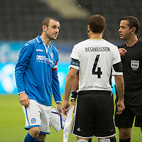 Rosenborg v St Johnstone....18.07.13  UEFA Europa League Qualifier.<br /> Referee Halis Ozkahya flips the coin with Dave Mackay and Tore Reginiussen<br /> Picture by Graeme Hart.<br /> Copyright Perthshire Picture Agency<br /> Tel: 01738 623350  Mobile: 07990 594431