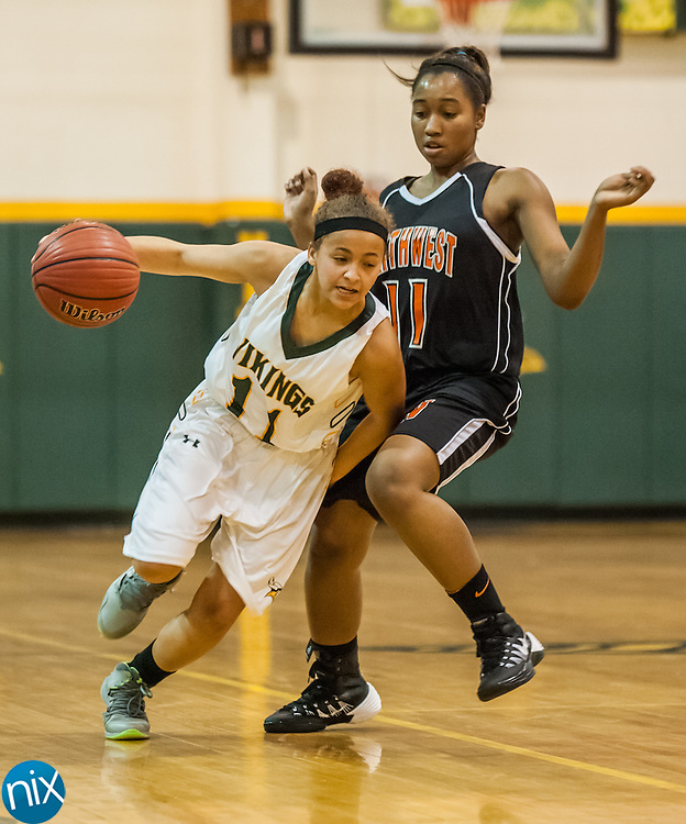 Central Cabarrus' Mahaley Holit drives past Northwest Cabarrus' Kierra Grant Friday night at Central Cabarrus High School. Central won the game 53-48.