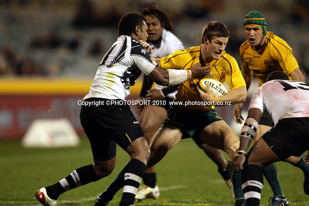 Robert Horne tackled by Timoci Nagusa<br /> <br /> International Test rugby union match, Australia v Fiji, Canberra, Australia. Saturday 5 June 2010. Photo: Paul Seiser/PHOTOSPORT