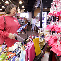 Adam Robison | BUY AT PHOTOS.DJOURNAL.COM<br /> Emily Wiggins, of Algoma, shops for a small purse at The Corner Shoe Store in Tupelo Friday afternoon.