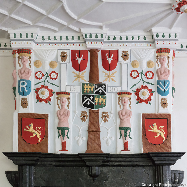 Fireplace in the hall, showing the quartered arms of the Wynn family, surrounded by badges and caryatids, Plas Mawr, Conwy.