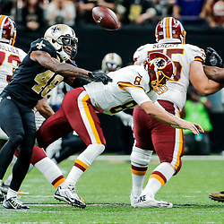 Nov 19, 2017; New Orleans, LA, USA; New Orleans Saints safety Vonn Bell (48) forces a fumble by Washington Redskins quarterback Kirk Cousins (8) during the second half of a game at the Mercedes-Benz Superdome. The Saints defeated the Redskins 34-31 in overtime. Mandatory Credit: Derick E. Hingle-USA TODAY Sports