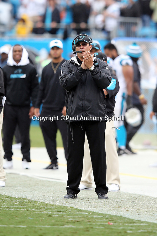 Carolina Panthers head coach Ron Rivera gives a claps after a score during the 2015 NFL week 3 regular season football game against the New Orleans Saints on Sunday, Sept. 27, 2015 in Charlotte, N.C. The Panthers won the game 27-22. (©Paul Anthony Spinelli)