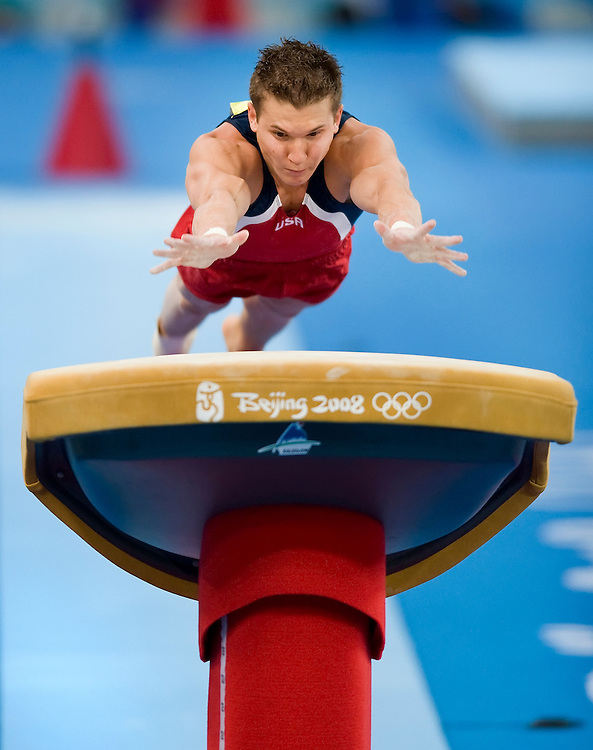 United States gymnast Jonathan Horton launched himself onto the vault appartus of the men's gymnastics team final August 12, 2008 at the National Indoor Stadium during the 2008 Summer Olympic Games in Beijing, China. China won the overall gold medal, Japan the silver and the United States the bronze. (photo by David Eulitt/MCT)