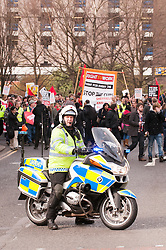 Police motor cyclist leads the Anti Cuts march during the Liberal Democrats conference in Sheffield
