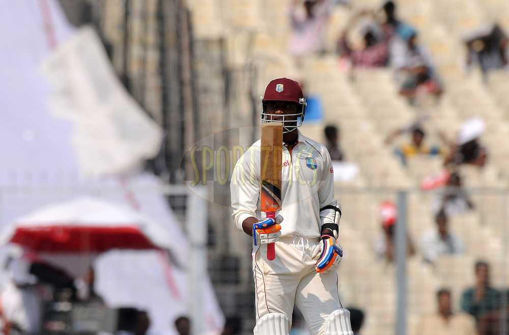 Marlon Samuels of West Indies celebrates after scoring a half century during the 4th day of the 2nd test match between India and The West Indies held at Eden Gardens in Kolkata, India on the 17th November 2011..Photo by Pal Pillai/BCCI/SPORTZPICS