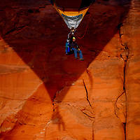 Ernie Hartt flies solo while casting a shadow against a cliff face during the 37th Red Rock Balloon Rally at Red Rock Park Dec 2.