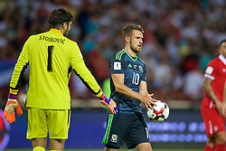 BELGRADE, SERBIA - Sunday, June 11, 2017: Serbia's goalkeeper Vladimir Stojkovic hands the ball off Aaron Ramsey before a penalty-kick during the 2018 FIFA World Cup Qualifying Group D match between Wales and Serbia at the Red Star Stadium. (Pic by David Rawcliffe/Propaganda)