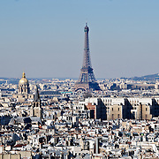 Eiffel Tower on Paris skyline, taken from the top of Notre Dame Cathedral, looking west.
