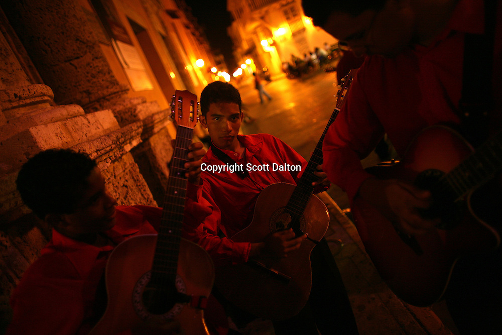 Guitarists gather in the Plaza Santo Domingo in Cartagena?s old city on Saturday, April 19, 2008. Cartagena is Colombia?s most popular tourist destination, located on the Caribbean cost the city?s history and charm enchants visitors from all over the world. (Photo/Scott Dalton).