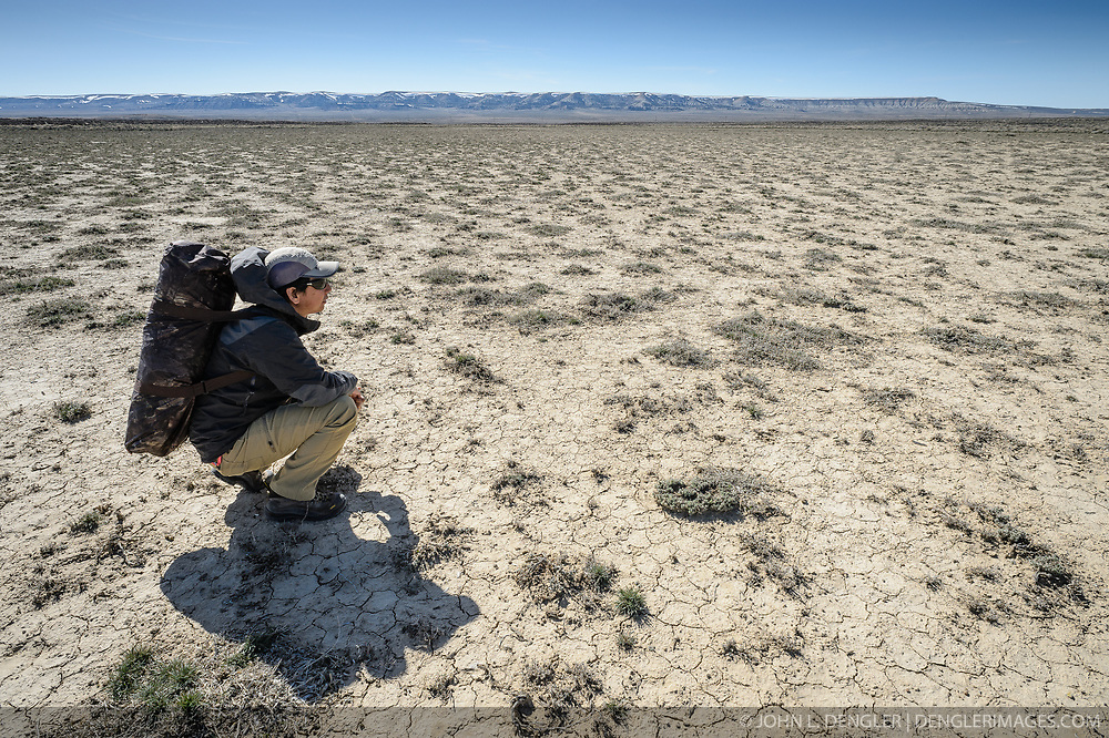 Wildlife photojournalist Noppadol Paothong trying to locate a greater sage-grouse lek in southwest Wyoming. ©John L. Dengler / DenglerImages.com