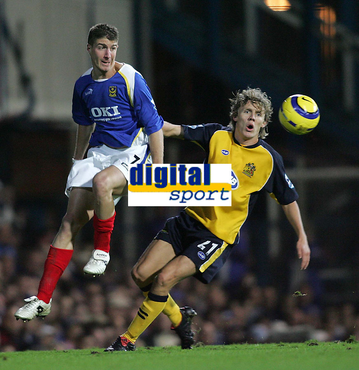 Photo: Lee Earle.<br /> Portsmouth v Wigan Athletic. The Barclays Premiership. 05/11/2005. Portsmouth's Gregory Vignal (L) and Wigan's Jimmy Bullard keep their eye on the ball.