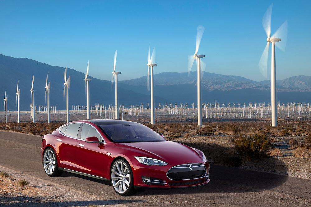 front view of Red 2015 Tesla Model S P85+ photographed amongst the power generating windmills of Palm Springs, CA