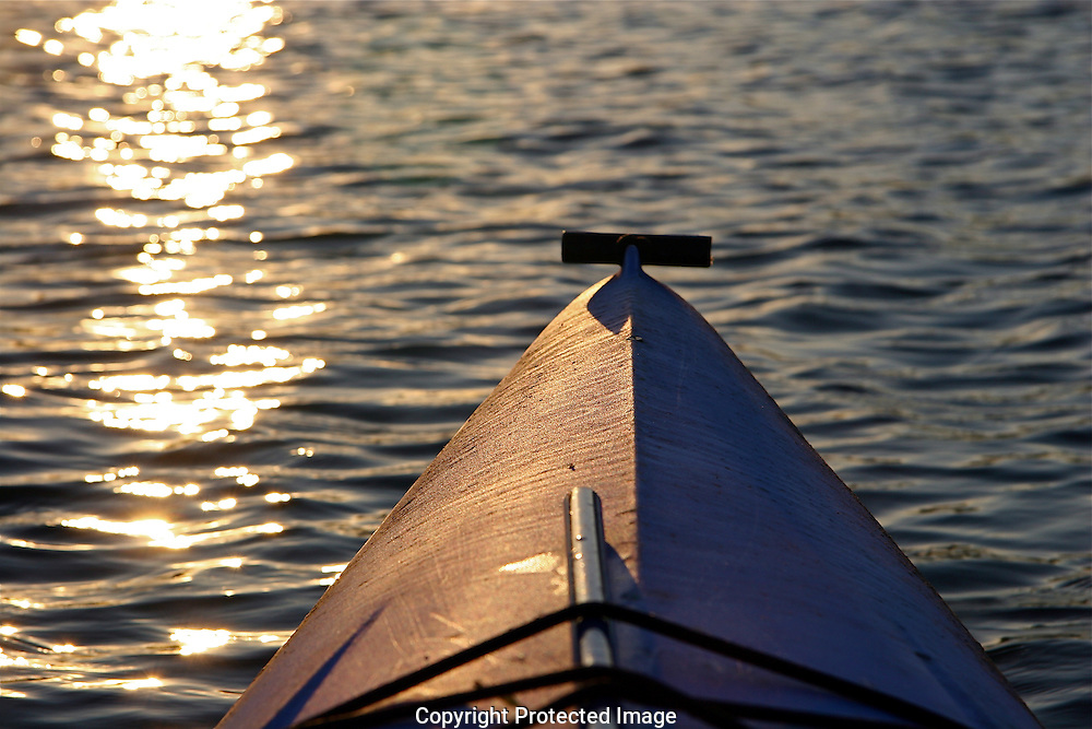 Kayak at sunset, Chester River, Chestertown, Maryland