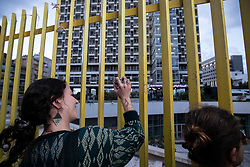 ©2020 Tom Nicholson. 11/01/2020. Beirut, Lebanon. A woman bangs a stone on the railings outside 'Electricité du Liban', the main Lebanese electricity provider. Demonstrators are taking part in a protest march from Daoura in east Beirut to Parliament in Downtown Beirut. The demonstrations are part of a wider movement which started in mid October 2019, campaigning against government corruption and economic crisis. Photo credit : Tom Nicholson