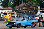 Pick up truck carrying a large load of small tree branches in Tamale, northern Ghana, on Sunday June 3, 2007.