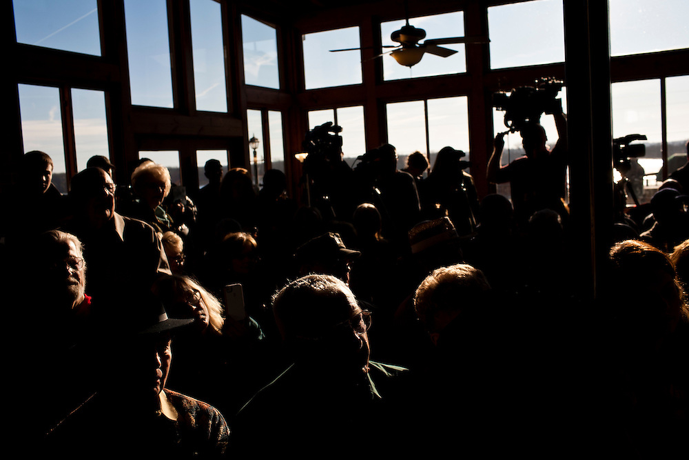 People listen to Republican presidential candidate Newt Gingrich at a campaign meet and greet at Elly's Tea and Coffee on Tuesday, January 3, 2012 in Muscatine, IA.
