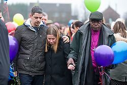 © Licensed to London News Pictures. 16/01/2017. York UK. Picture shows Katie Rough's parents Paul Rough & Alison Rough (left) with the Arch Bishop of York. Katie's parents where joined by hundreds of people in Westfield Park in York this afternoon to release balloons on what would have been Katie's 8th birthday. Katie died last week after being found with significant cuts to her neck & chest.  Photo credit: Andrew McCaren/LNP