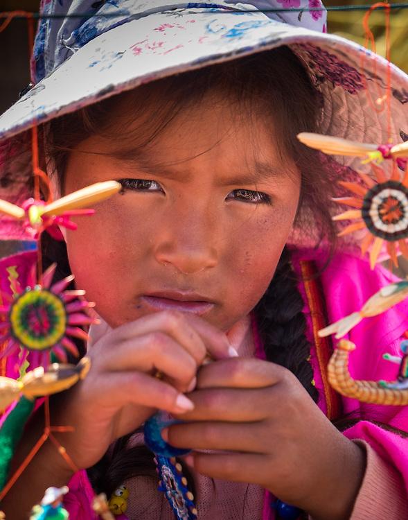 UROS ISLANDS, PERU - CIRCA APRIL 2014: Girl from the Uros Islands in Lake Titicaca.
