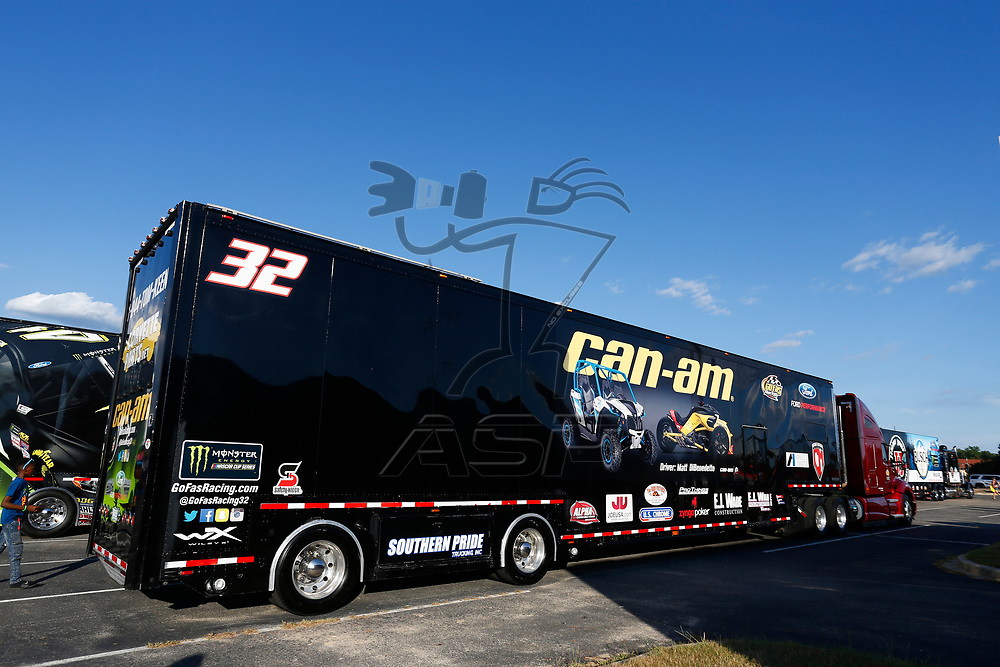 The hauler for Matt DiBenedetto (32) parades through town on the way to the the Bojangles' Southern 500 weekend at Darlington Raceway in Darlington, South Carolina.