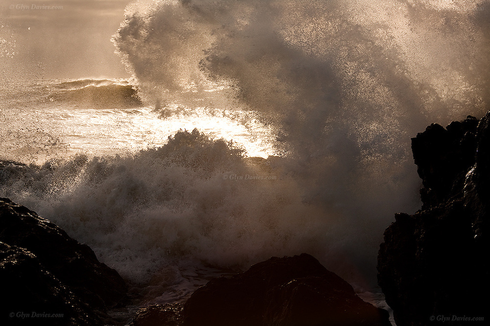 Huge storm waves exploding with full force on the rocks at Silver Bay near Rhoscolyn.