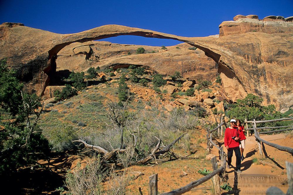 Hikers below Landscape Arch, Devils Garden Trail Arches National Park, UTAH