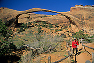 Hikers below Landscape Arch, Devils Garden Trail Arches National Park, UTAH