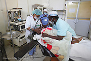 3 years old , FANAMBINANJANAHARY Fenomamama Fandresena with Anesthesiologist RAVONIARISOA Jeanette in the Operating Room ahead of his surgery for hernia at Antsaribe Hospital. Antsirabe Clinic Project sponsored by the Swedish Postal Code lottery. Madagascar. September 2015.<br /> (Operation Smile Photographer &ndash; Zute Lightfoot)