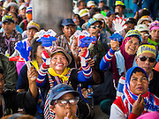 """08 APRIL 2014 - BANGKOK, THAILAND:  Anti-government protestors cheer for Suthep Thaugsuban while they block the entrance to the Ministry of Justice in Bangkok. Several hundred anti-government protestors led by Suthep Thaugsuban went to the Ministry of Justice in Bangkok Tuesday. Suthep and the protestors met with representatives of the Ministry of Justice and expressed their belief that Thai politics need to be reformed and that corruption needed to be """"seriously tackled."""" The protestors returned to their main protest site in Lumpini Park in central Bangkok after the meeting.   PHOTO BY JACK KURTZ"""