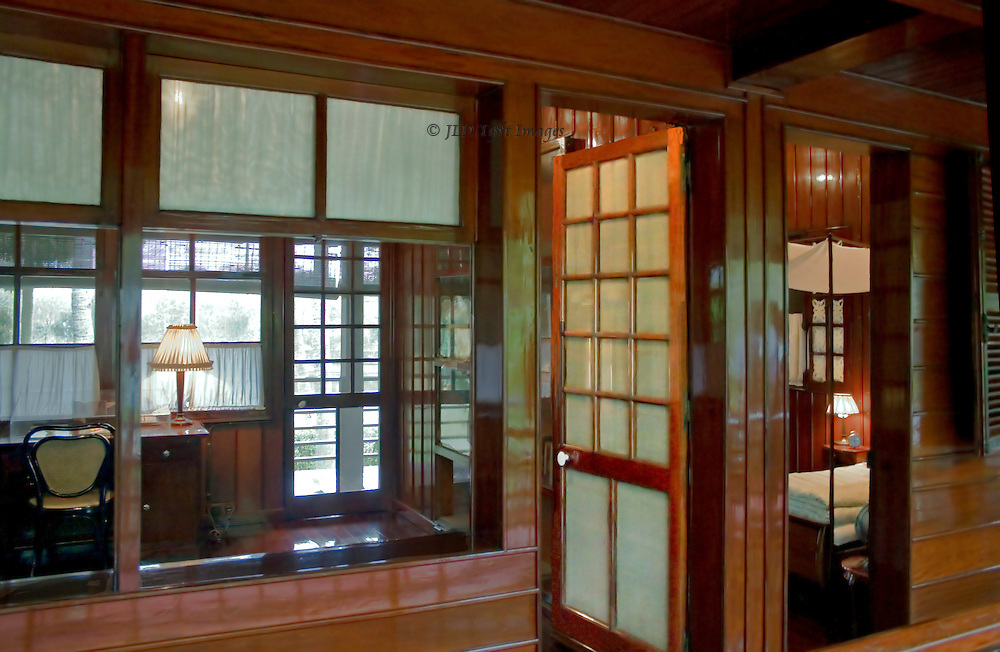 Ho Chi Minh's Stilt House, where he lived and worked, in Hanoi.  View of the interior, showing study (left) and bedroom (right).  The house is small and simple, as Ho Chi Minh lived simply.  Its spacial design and surfaces are exquisite and elegant however. the image composition is a rather rigid geometric.