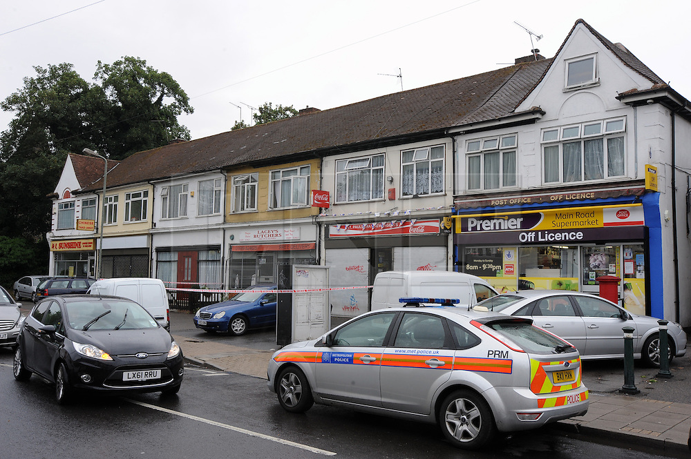© Licensed to London News Pictures. 16/08/2013<br /> Cray Parade shops.<br /> A Kent shopkeeper is in hospital this morning after being attacked and his newsagents robbed.<br /> The robbery took place this morning (16.08.2013) at Number 5, Cray Parade, St Pauls Cray  Newsagents, Main Road, St Pauls Cray, Orpington, Kent.<br /> Police scenes of crime are at the shop taking DNA and finger prints.<br />  Photo credit :Grant Falvey/LNP
