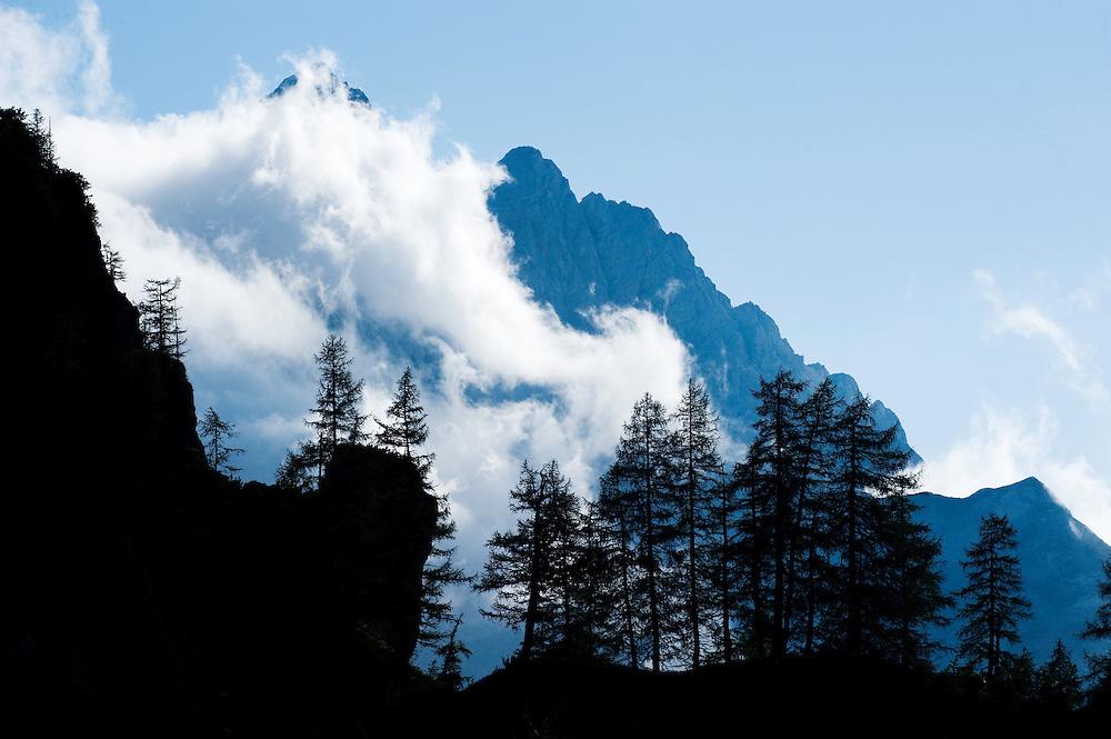 Mount Jalovec in fog, view from &quot;Sleme&quot;<br /> Julian Alps<br /> Triglav National Park, Slovenia<br /> July 2009