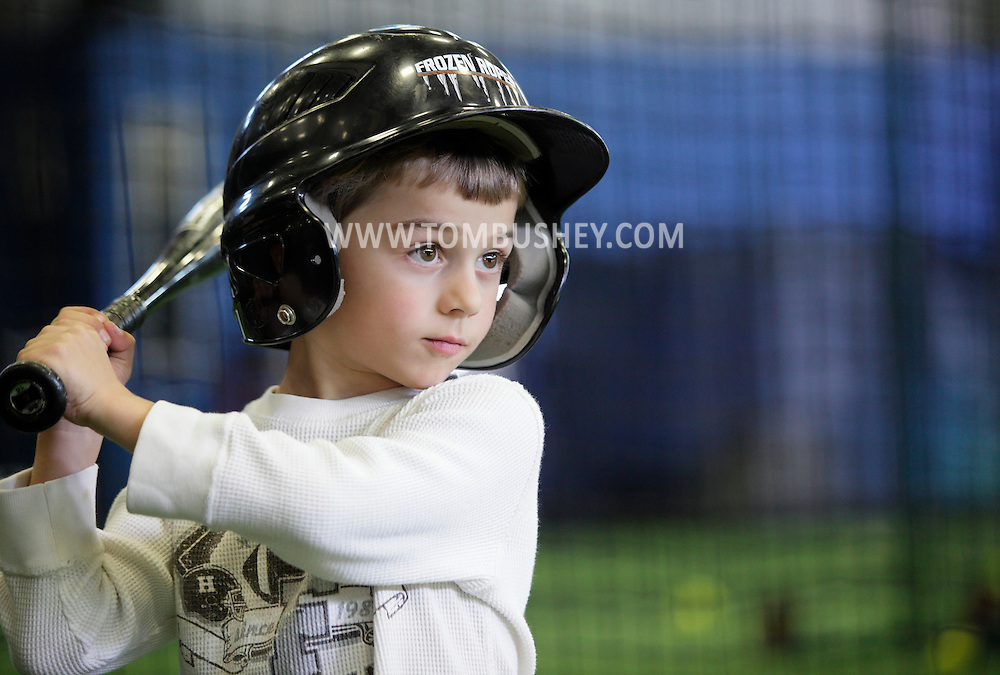 Chester, New York - A boy gets ready to take a swing in a batting cage during the first anniversary open house celebration at The Rock Sports Park on Nov. 12, 2011.