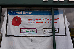 "© Licensed to London News Pictures. 19/06/2015. London, UK. A sign stating ""Internal Error. Marketisation programme has crashed education"" in the window of the Elephant and Castle pub in Southwark, south-east London. A group of activists have occupied the Elephant and Castle pub and are squatting in it to prevent Foxtons Estate Agents from opening an Estate Agent branch. The activists, who are against gentrification want the historic pub site to become a community asset with open use. The Elephant and Castle pub closed earlier this year after its license was revoke and in April, representatives of Foxtons notified planning authorities that they intend to open a branch of the estate agents chain in the pub. Photo credit : Vickie Flores/LNP"