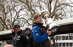 Helmsman Peter Burling, right, holds the Americas Cup trophy in the Octagon during Emirates Team New Zealand's victory parade in Dunedin, New Zealand, Thursday, July 13, 2017. Credit:SNPA / Adam Binns ** NO ARCHIVING**