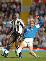 Photo: Leigh Quinnell.<br /> Birmingham City v Newcastle United. The Barclays Premiership. 29/04/2006. Birminghams Jiri Jarosik challenges Newcastles  Amdy Faye.