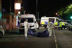 © Licensed to London News Pictures. 26/07/2020. Manchester, UK. The scene on Henbury Street, Moss Side, where a 17 year old boy was stabbed to death and three others stabbed causing injuries, this evening. Photo credit: Joel Goodman/LNP
