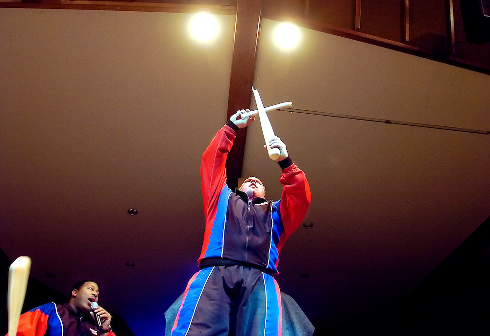 022507     Brian Leddy.Jeremy Baker of the Power Team raises a bat he just broke over his knee into the sign of a cross while Tim Spigner helps with the performace during Sunday evening's show at First Baptist Church. The Power Team is Dallas, Tex. based Christian ministry aimed at spreading the message of the bible through its use of power, strength and speed.