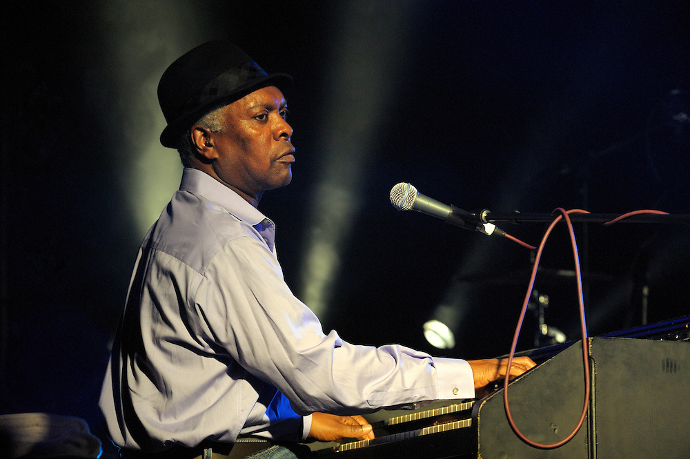Booker T. Jones, US blues singer musician plays Hammond B3 organ. Main stage marquee. Maryport Blues Festival, 2010. England